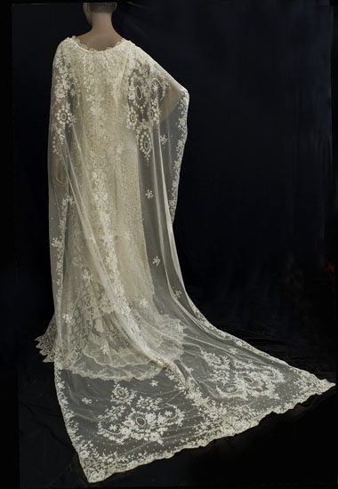 Lace cape edwardian wedding dress